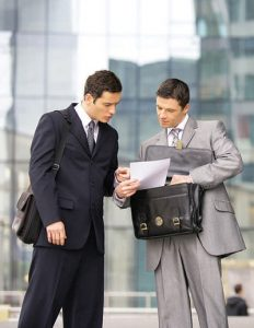 Business Men Looking at a Document